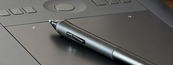 imagem de caneta e notebook